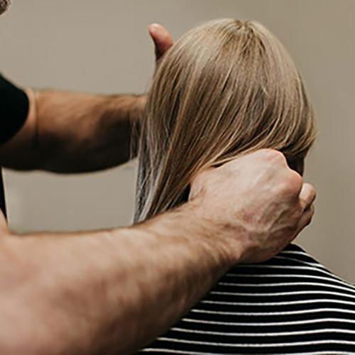 Chiropractor Addison TX Dr. David Bynum Adjusting Patient